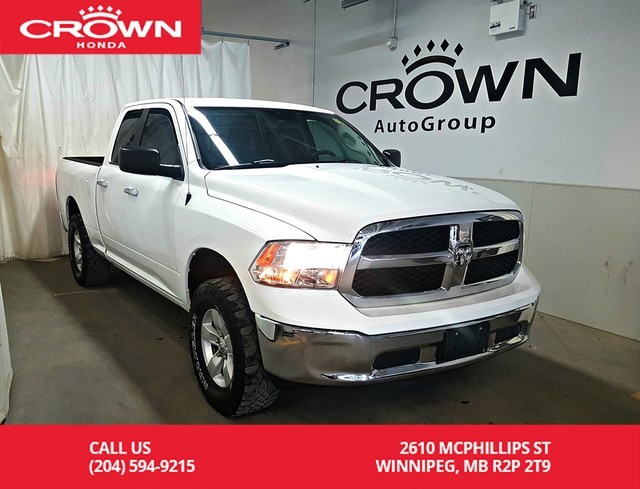 Pre-Owned 2014 Ram 1500 4WD Quad Cab 140.5 SLT/one owner